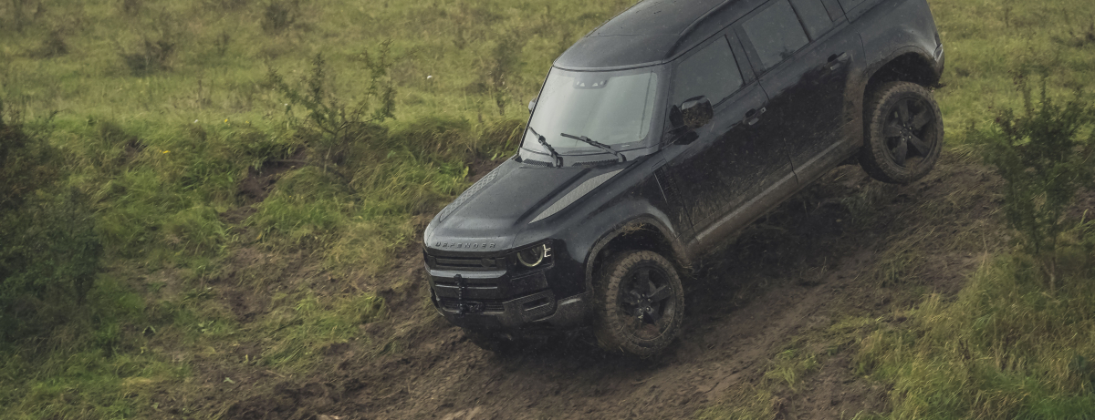Behind the scenes image of the New Land Rover Defender featured in No Time To Die