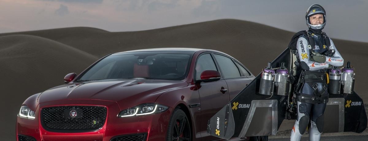 F1 Star Martin Brundle and New Jaguar XJR Take on High-Flying 'Jetman' Yves Rossy in World-First Desert Drag Race