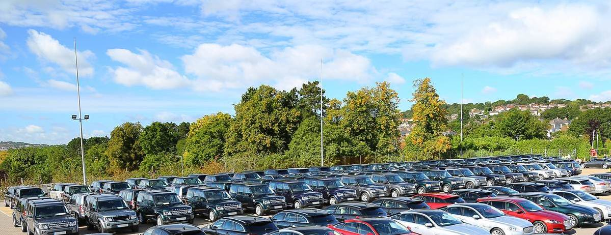 At Ease: A Fleet Of Jaguar And Land Rover Vehicles Stand