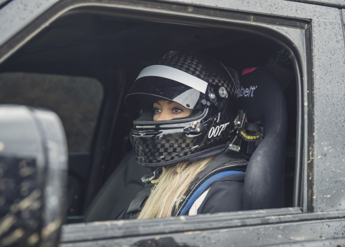 Behind the scenes image of Stunt Driver Jessica Hawkins with the New Defender featured in No Time To Die